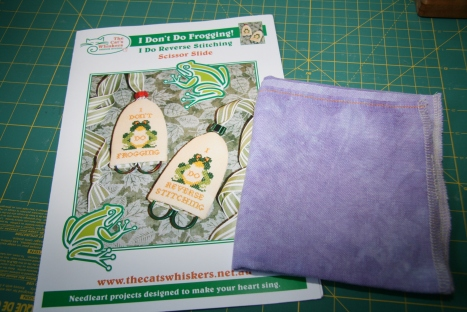 Stash!  Cat's Whiskers chart and a hunk of purple fabric for LK Boo series